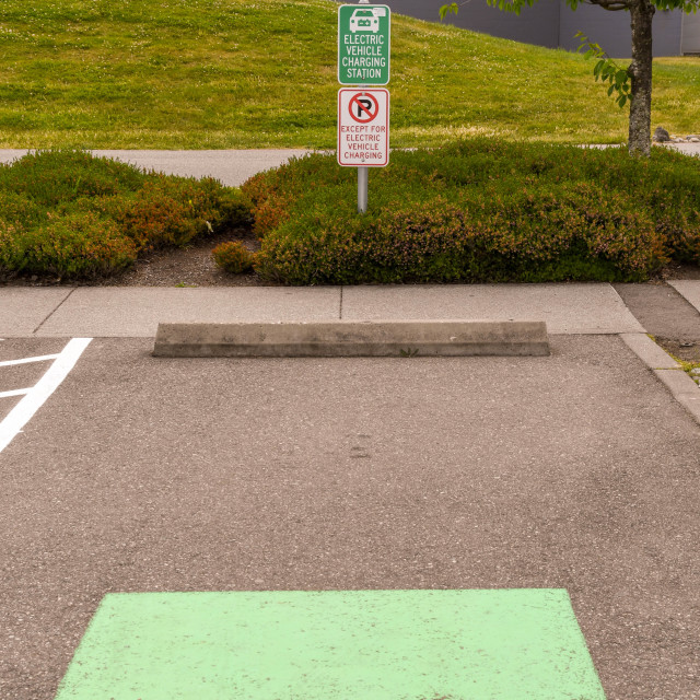 """""""Parking bay reserved for visitors with electric cars"""" stock image"""
