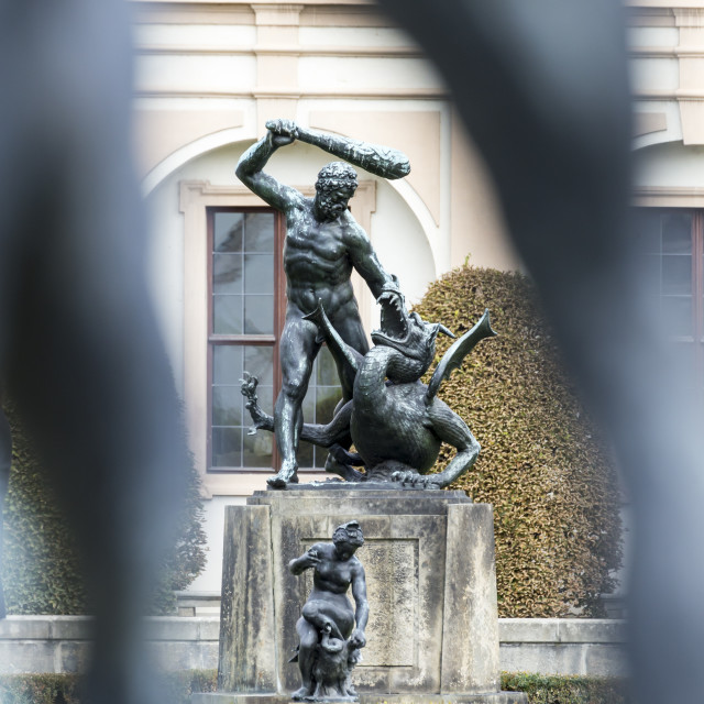 """Bronze statues in a garden"" stock image"