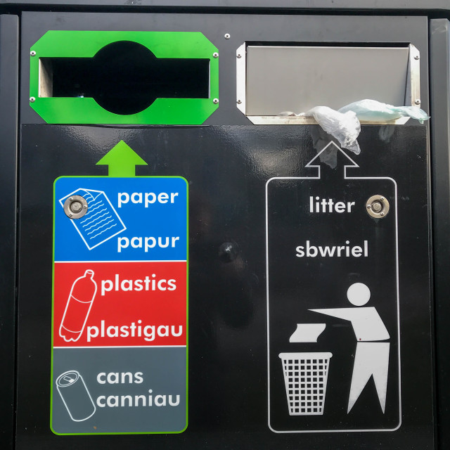 """""""ST DOGMAELS, PEMBROKESHIRE, WALES - NOVEMBER 2018: Close up view of the front of a large bin provided for litter and recycling materials in the West Wales village of St Dogmaels."""" stock image"""