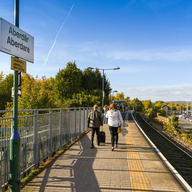 """Commuters walking along the platform in Aberdare."" stock image"