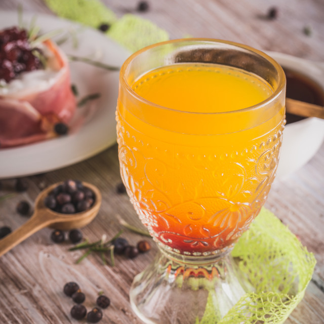 """""""Glass with orange juice on wooden board with whole camembert"""" stock image"""