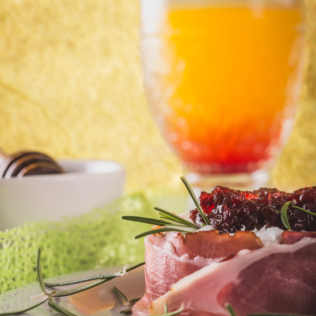 """""""Whole camembert wrapped in dry ham with cranberries on top"""" stock image"""