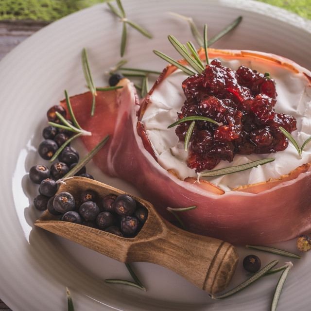 """Whole camembert wrapped in dry ham with cranberries on top"" stock image"