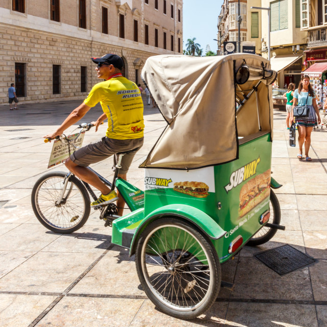"""""""A tricycle taxi looking for business."""" stock image"""