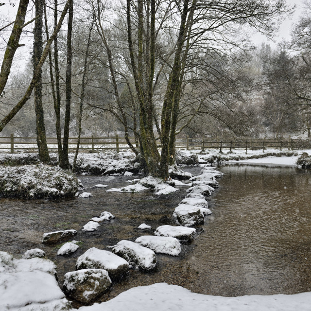 """Stepping stones across the river in snow"" stock image"
