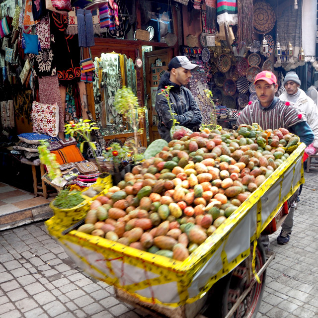 """A trader pushes a loaded trolley in Morocco"" stock image"