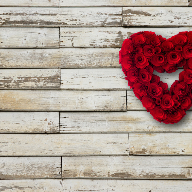 """Heart made of wooden roses red painted hanging from a wall"" stock image"