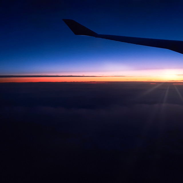 """""""Silhouetted airplane wing during a night flight"""" stock image"""