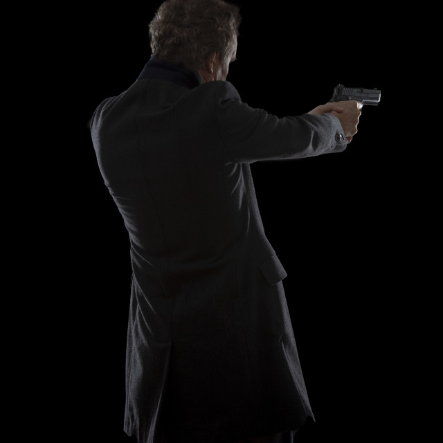 """""""silhouette of a man with a gun"""" stock image"""