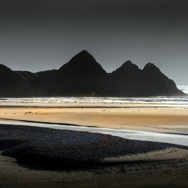 """Grey sky at Three Cliffs Bay"" stock image"