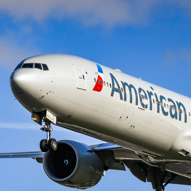 """""""Close up of an American Airlines Boeing 777 jet in flight"""" stock image"""