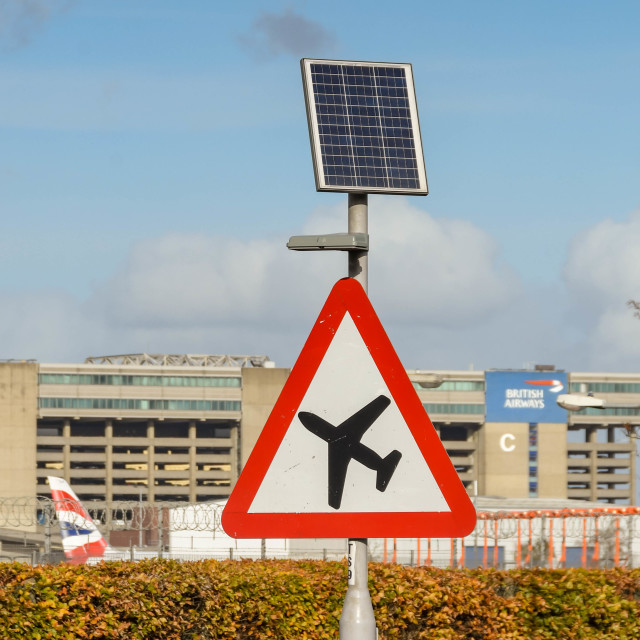 """""""Road sign warning motorists of low flying aircraft."""" stock image"""