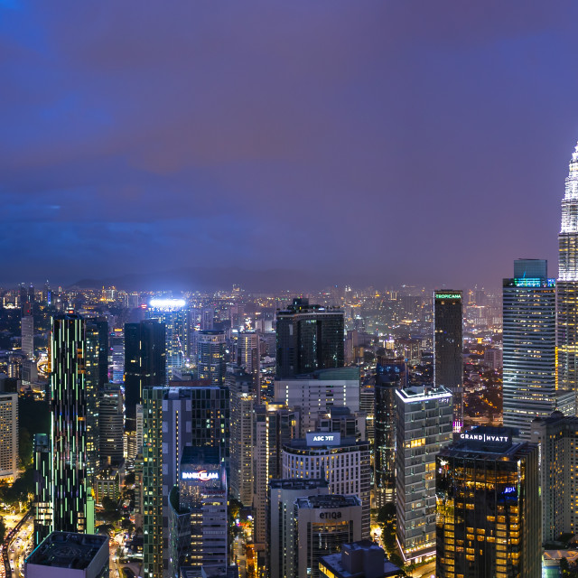"""Panorama shot of sunset at Kuala Lumpur city skyline"" stock image"