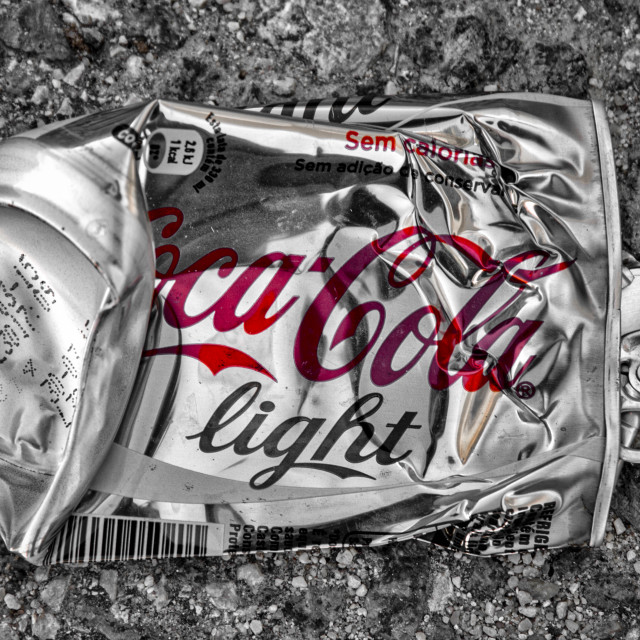 """""""squashed coca cola tin in black and white and red."""" stock image"""