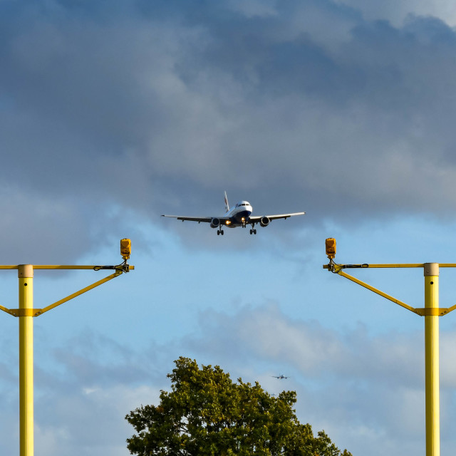 """""""Landing lights at London Heathrow Airport with plane"""" stock image"""