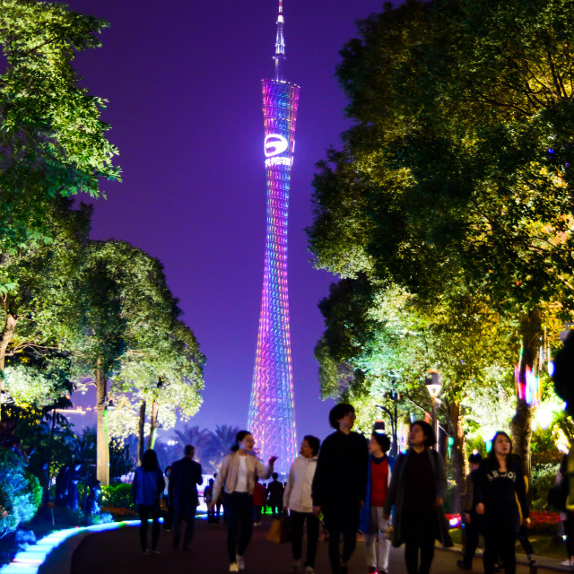 """""""Canton tower and Guangzhou Xiancun modern downtown area views of modern skyscrapers and tourists walking by"""" stock image"""
