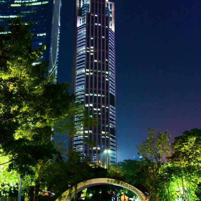 """Guangzhou Xiancun modern downtown area views of modern skyscrapers and tourists walking by"" stock image"