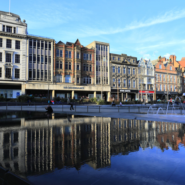 """""""City centre shops reflected in the infinity pool, and fountains, Old Market..."""" stock image"""