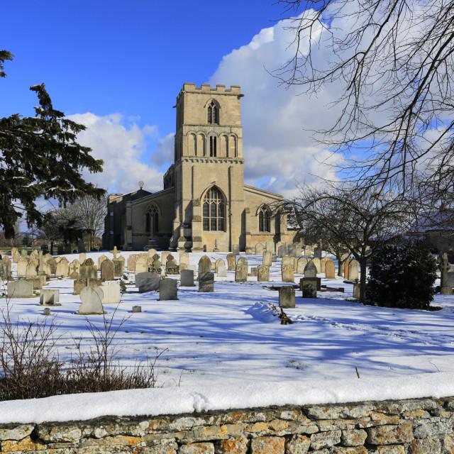 """Winter snow, St Peters church, Maxey village, Cambridgeshire England UK"" stock image"