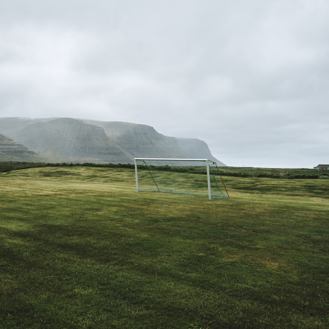 """An empty remote football pitch in a dramatic landscape."" stock image"