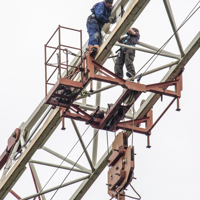 """""""Two construction workers in a crane truss"""" stock image"""