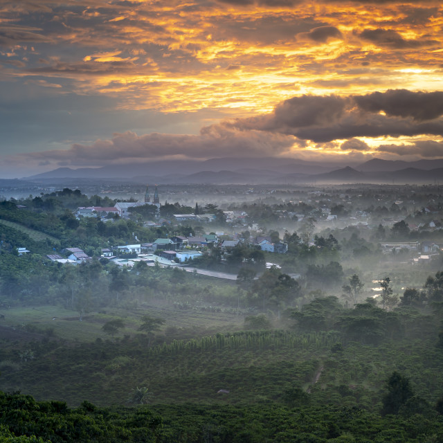 """""""Sun rays at the valley on Bao Loc town. The far side is Thanh Xa Church in Lam Dong province, Vietnam."""" stock image"""