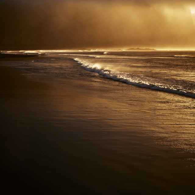"""""""An empty windswept beach at sunset"""" stock image"""