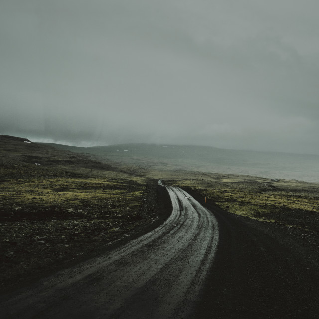 """An empty moorland landscape road through low grey clouds"" stock image"