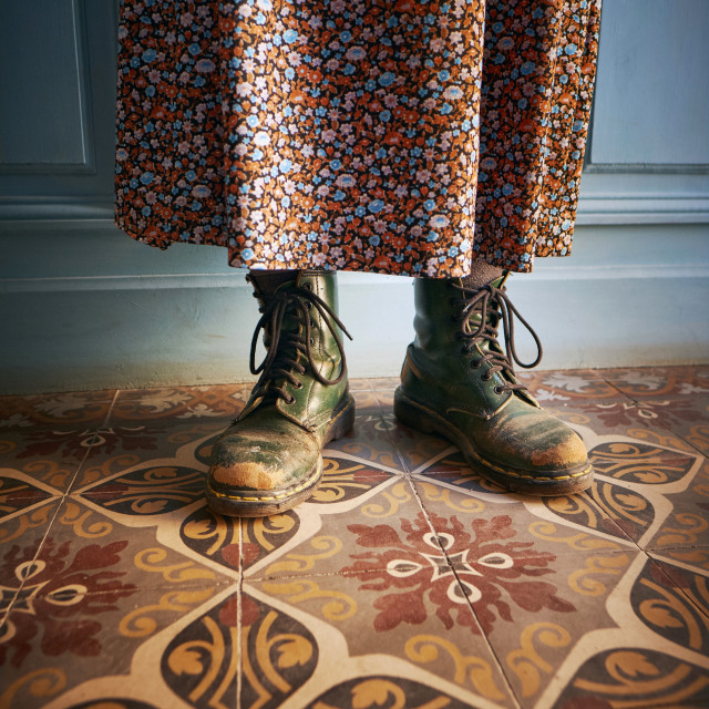 """""""Worn green laced boots and skirt"""" stock image"""