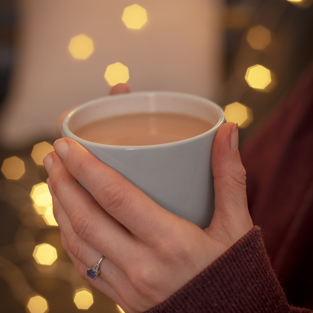 """""""close up of a woman holding a cup of tea"""" stock image"""