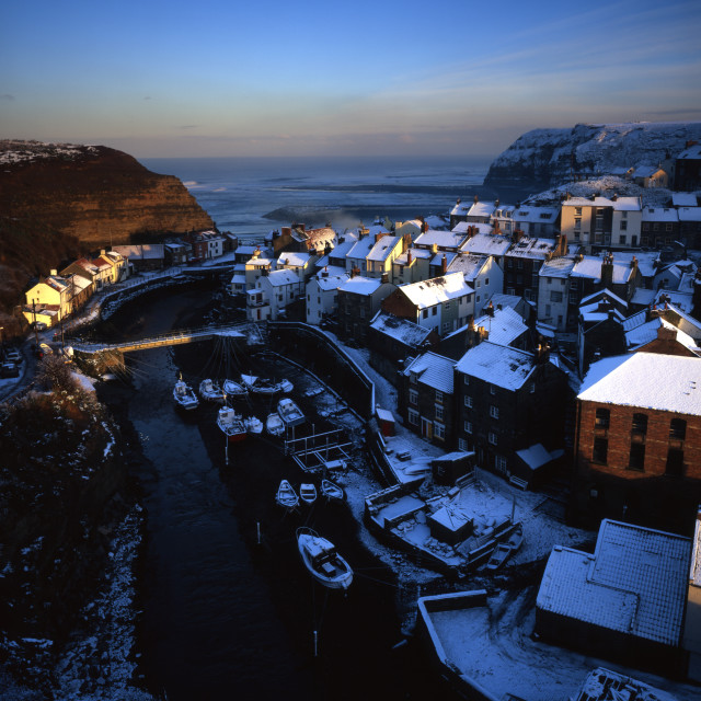 """Snow Covered Rooftops at Staithes on the Yorkshire Coast"" stock image"