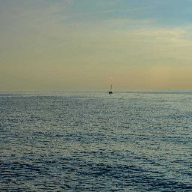 """Sailing boat on the horizon"" stock image"