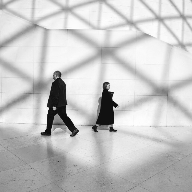 """""""Visitors and shadows inside the British Museum in London England."""" stock image"""