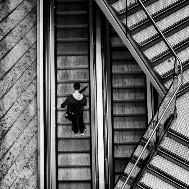 """Man on escalator Liverpool"" stock image"