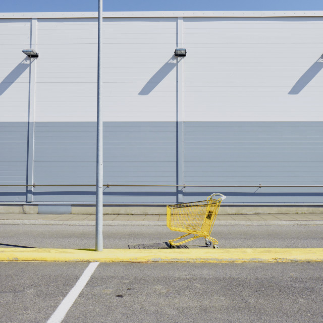 """""""Yellow empty shopping trolley."""" stock image"""