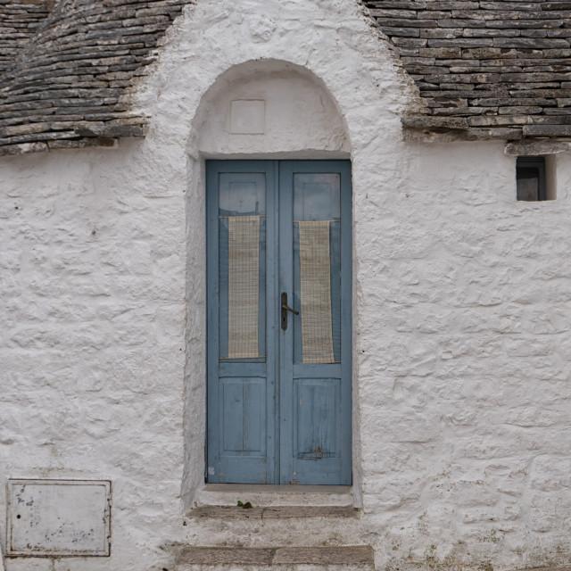 """""""Trullo with blue door in Alberobello in Puglia"""" stock image"""