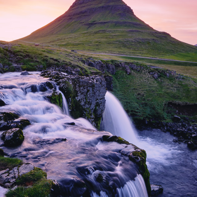 """""""Waterfall and mountain at sunset"""" stock image"""