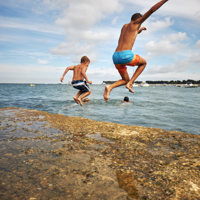 """""""Leaping into summer :-)"""" stock image"""