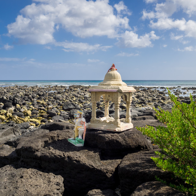 """Shrine and statue of Hindu deity Lord Hanuman on rocks by sea, P"" stock image"