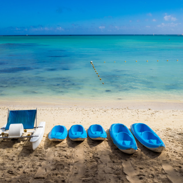 """Pedalo and canoes on Mon Choisy beach, Mauritius, Indian Ocean"" stock image"