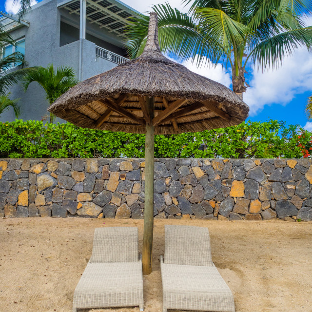 """Sun loungers on the beach, Pointe aux Piments, Mauritius"" stock image"