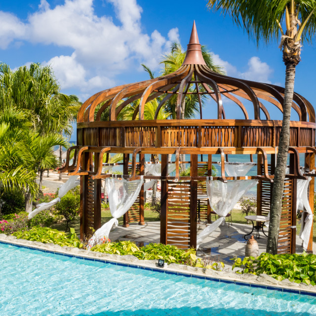 """Wooden canopy with net curtains by pool at Le Meriden Ile Mauric"" stock image"