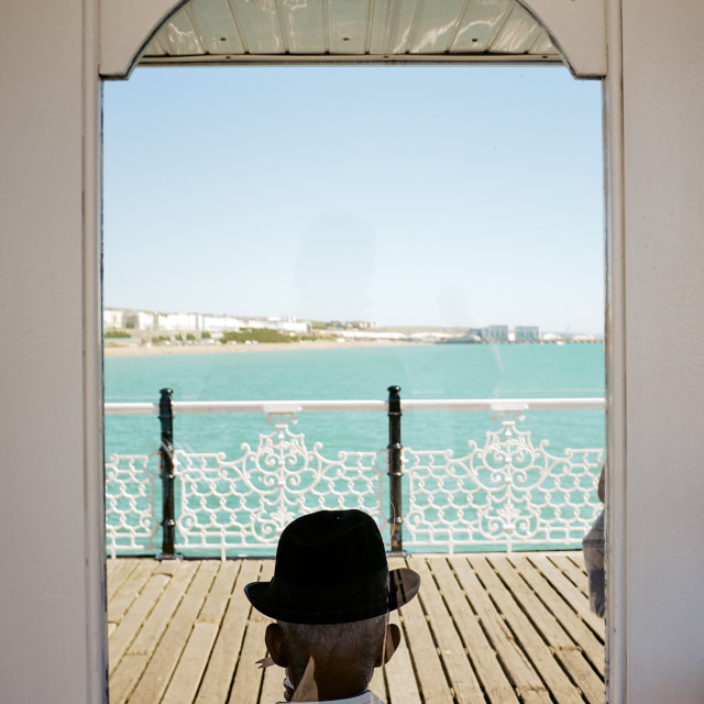 """A Trilby hat on Brighton Pier"" stock image"