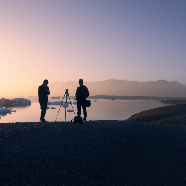 """""""Landscape photographers in the midnight Iceland landscape."""" stock image"""