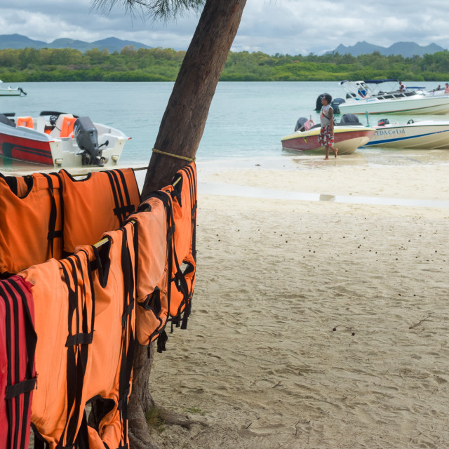"""Life jackets hanging out to dry on on the island of Île aux C"" stock image"