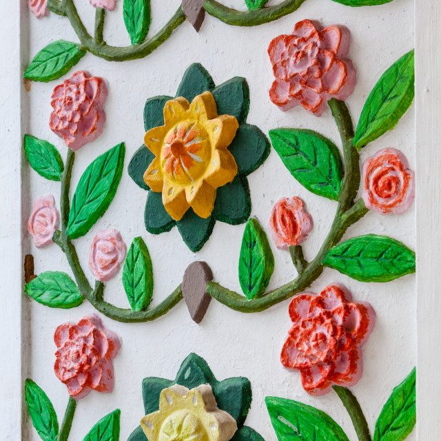 """Close up detail of flower artwork on entrance pillar to main tem"" stock image"