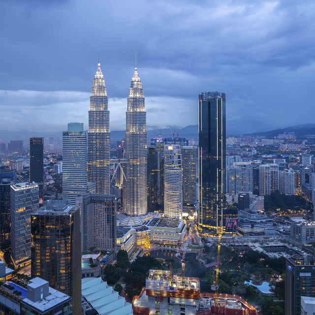 """Aerial view of cloudy sunset blue hour at Kuala Lumpur city skyl"" stock image"