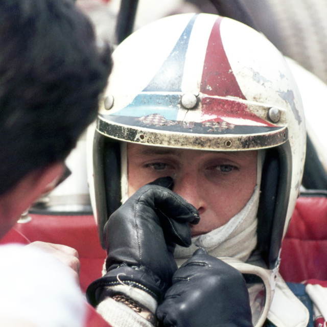 """""""Chris Amon in discussion, Silverstone"""" stock image"""