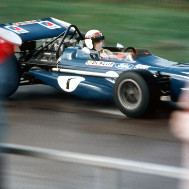 """""""Jackie Stewart at speed passing the Silverstone Pits"""" stock image"""