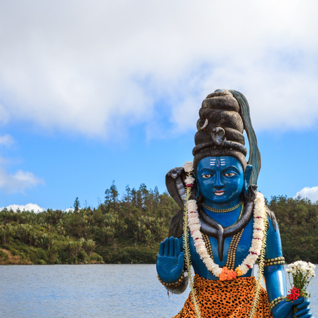 """Statue of Hindu god Lord Shiva outside temple on the holy lake o"" stock image"